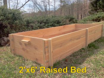 Raised garden beds offer an easier, more efficient method for planting small gardens.  Our beds are made from rough western red cedar and are ready to assemble, no special tools required.  Western red cedar is naturally rot and insect resistant without the harsh chemicals used in treated lumber and will last for years.  These beds are 6 feet long by 2 feet wide by 11 inches deep; the 2 foot width makes it very easy to reach your plantings.  12 cubic feet (about half a cubic yard) of soil mixture fills them nicely for growing vegetables such as lettuce, radishes, carrots, tomatoes, cucumbers, strawberries, and even potatoes.  We also sell a variety of trellis frames to support taller vegetables like tomatoes or vine vegetables like cucumbers.